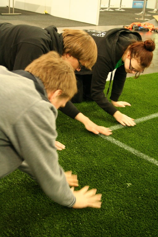 Examining_artificial_turf